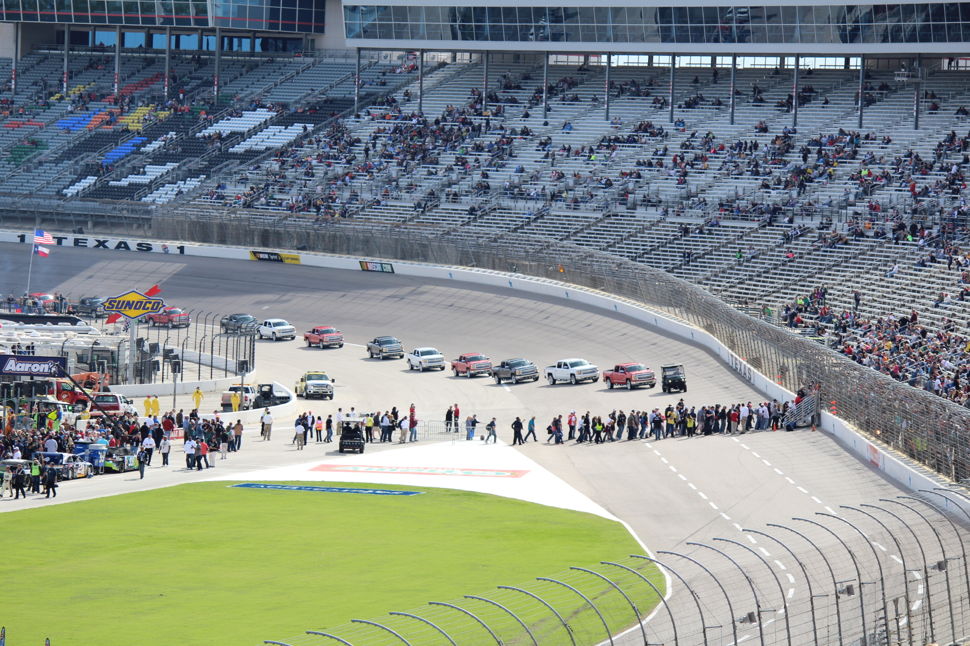 Before the Nascar Race...all the 2014 Chevrolet Silverado's lining up to pick up the drivers