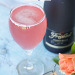 This Raspberry Champagne Cocktail is a play on the French Martini. It pairs homemade raspberry simple syrup, pineapple juice vodka and champagne. So good!