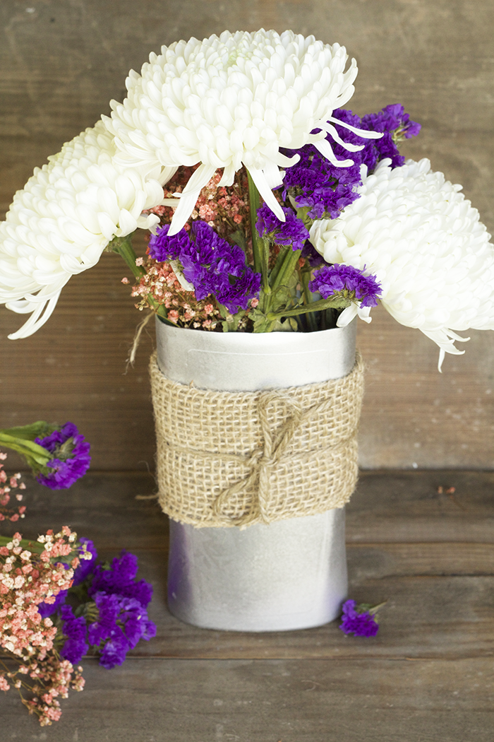 Have left over Shampoo Bottles? What about Conditioner or Lotion bottles? Then you can totally make yourself a super cute DIY Upcycled Flower Vase! So simple too and the perfect kid craft!