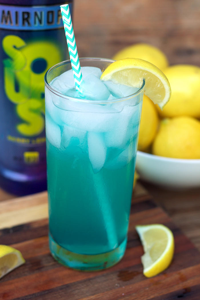 Sharing a fun cocktail with you to celebrate #NationalVodkaDay with this Electric Lemonade featuring Smirnoff Sours Lemon Berry